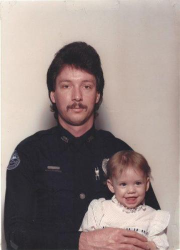 Les as a young JPD officer and single dad with his daughter, Angelia